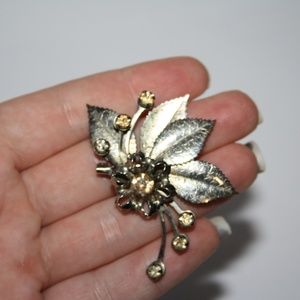 Vintage Jewelry - Vintage silver and rhinestone flower brooch